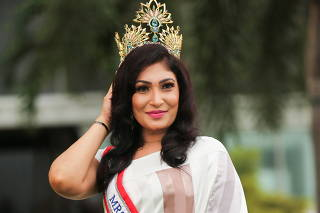 Pushpika De Silva poses for photographs with her Mrs Sri Lanka crown in Colombo