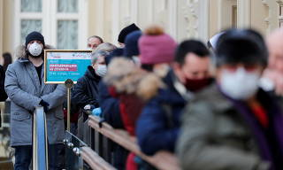 Peoplelineup to receive a dose of Sputnik V (Gam-COVID-Vac) vaccine against the coronavirus disease (COVID-19) in Moscow