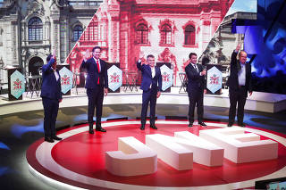 FILE PHOTO: Presidential candidates debate in Lima, Peru