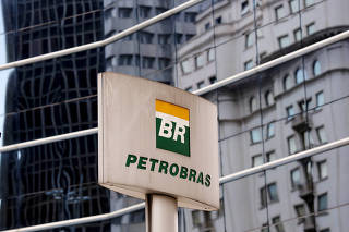 FILE PHOTO: The Petrobras logo is seen in front of the company's headquarters in Sao Paulo