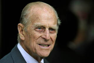 FILE PHOTO: Britain's Prince Philip smiles during his visit with Queen Elizabeth to the Irish National Stud in Kildare