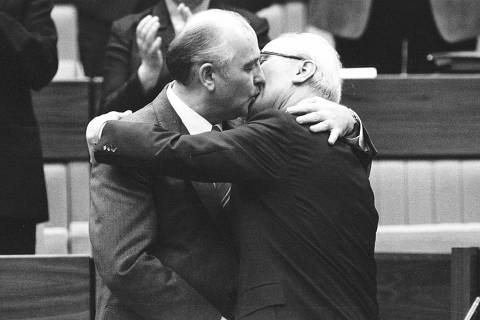 ORG XMIT: 271001_1.tif Then Soviet Leader Mikhail Gorbachev (L) congratulates the East German Leader Erich Honecker with a fraternal hug and kiss after Honecker's re-election as General Secretary of the Communist Party Congress in East Berlin, in this April 21, 1986 file picture. Gorbachev, the father of the Soviet Perestroika reform programm, celebrates his 75th birthday on March 2, 2006. Picture taken April 21, 1986. (B/W ONLY) REUTERS/Gaby Sommer/Files