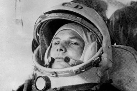 (FILES) In this file photo taken on April 12, 1961 Yuri Gagarin, 27, (1934-68) wearing cosmonaut helmet, prepares to board Soviet Vostok I spaceship at Baikonur rockets launch pad shortly before its take-off to became the first man to travel in space, completing a round-the-Earth circuit. - Sixty years ago Monday Soviet cosmonaut Yuri Gagarin became the first person in space, securing victory for Moscow in its race with Washington and marking a new chapter in the history of space exploration. (Photo by - / AFP) ORG XMIT: MAG01
