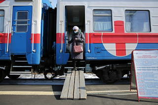 A woman leaves a carriage of the Academician Fyodor Uglov medical train in Tulun