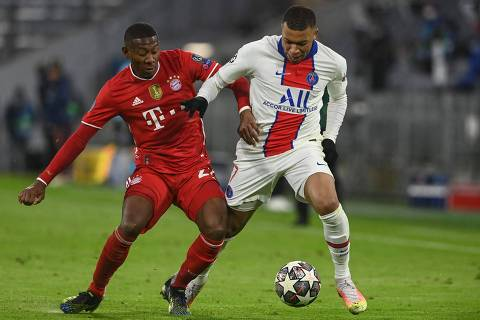 Bayern Munich's Austrian defender David Alaba (L) and Paris Saint-Germain's French forward Kylian Mbappe vie for the ball during the UEFA Champions League quarter-final first leg football match between FC Bayern Munich and Paris Saint-Germain (PSG) in Munich, southern Germany, on April 7, 2021. (Photo by Christof STACHE / AFP)