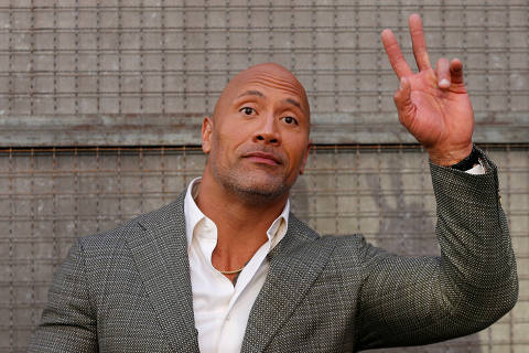 FILE PHOTO: Cast member Dwayne Johnson poses at the premiere for the movie
