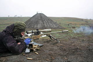 A sniper of the Ukrainian armed forces fires his rifle during training inDonetsk region