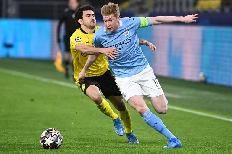 O meia Kevin De Bruyne, marcado por Mateu Morey, do Borussia Dortmund, é o grande nome do Manchester City e candidato a melhor da temporada