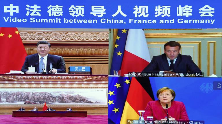 Reunião por vídeo entre o dirigente chinês Xi Jinping, à esq., o presidente francês, Emmanuel Macron, e a primeira-ministra alemã, Angela Merkel