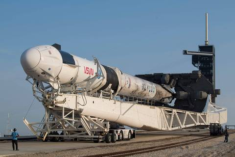 In this image released by NASA, a SpaceX Falcon 9 rocket with the company's Crew Dragon spacecraft onboard is rolled out of the horizontal integration facility at Launch Complex 39A during preparations for the Crew-2 mission, on April 16, 2021, at Kennedy Space Center in Florida. - NASA's SpaceX Crew-2 mission is the second crew rotation mission of the SpaceX Crew Dragon spacecraft and Falcon 9 rocket to the International Space Station as part of the agency's Commercial Crew Program. NASA astronauts Shane Kimbrough and Megan McArthur, ESA (European Space Agency) astronaut Thomas Pesquet, and Japan Aerospace Exploration Agency (JAXA) astronaut Akihiko Hoshide are scheduled to launch on April 22. (Photo by Aubrey GEMIGNANI / NASA / AFP) / RESTRICTED TO EDITORIAL USE - MANDATORY CREDIT