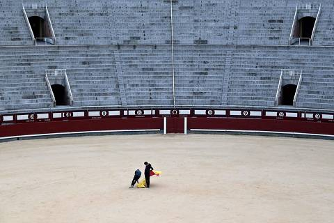 Pupils practice at the Bullfighting School in Las Ventas bullring in Madrid on February 4, 2021. (Photo by Gabriel BOUYS / AFP)