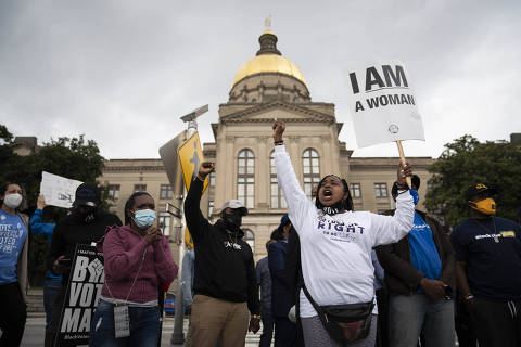 People protest outside the Georgia Capitol in Atlanta against a House bill on voting restrictions, Thursday, March 25, 2021. The Georgia House of Representatives on Thursday passed a sweeping bill to limit voting access in the state, clearing a major hurdle in the Republican-led effort to rewrite many of the state's voting regulations after the 2020 election. (Nicole Craine/The New York Times) ORG XMIT: XNYT183
