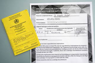 A screenshot from Government spokesman Twitter account shows vaccination documents for German Chancellor Angela Merkel