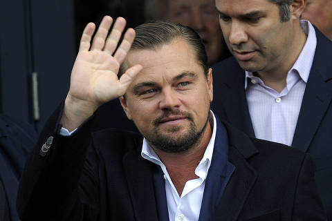 (FILES) In this file photo US actor Leonardo Di Caprio arrives at a social restaurant that aims to help the homeless in Edinburgh, Scotland ahead of his appearance this evening at the Scottish Business Awards on November 17, 2016. - Already the master of 2020's pandemic-era movie landscape, Netflix on January 12, 2021 offered a preview of upcoming 2021 releases, a list with no fewer than 70 star-studded feature films. The sneak peek is unusual for the streaming giant, which historically has dropped news of only one film at a time -- a testament to its clout as it easily surpasses the release volume of every Hollywood studio. From drama, comedy and science fiction to horror and even Westerns, the slate will take in every major film genre before the year is out, with some releases poised as potential competition for major awards. Among the most-anticipated titles is