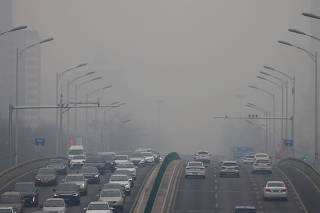 FILE PHOTO: Polluted day in Beijing