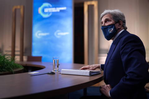 John Kerry, Special Presidential Envoy for Climate, looks up at a video screen while participating in a virtual Climate Summit with world leaders in the East Room at the White House in Washington, U.S., April 22, 2021. REUTERS/Tom Brenner ORG XMIT: PPPWAS620