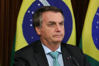 Brazil's President Bolsonaro attends a virtual global climate summit via a video link in Brasilia