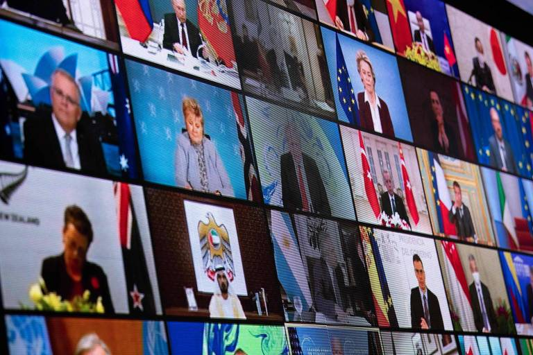 Líderes globais em telão durante a Cúpula do Clima, organizada pelos EUA