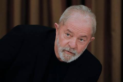 (FILES) In this file photo taken on February 18, 2020 Brazil's former president Luiz Inacio Lula da Silva is pictured during a meeting with deputies and senators of the Workers' Party (PT) in Brasilia. - Brazil's Supreme Court on April 22, 2021 upheld last month's ruling by one of its chambers that former judge Sergio Moro was