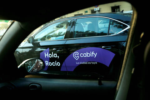 FILE PHOTO: A Cabify taxi car is seen through the window of a car in Malaga, southern Spain August 3, 2018. REUTERS/Jon Nazca//File Photo ORG XMIT: FW1