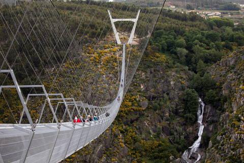 People walk on the world's longest pedestrian suspension bridge '516 Arouca', now open for local residents in Arouca, Portugal, April 29, 2021. REUTERS/Violeta Santos Moura ORG XMIT: GGG-VSM106