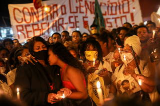 People protest against police violence outside Jacarezinho slum after a police operation which resulted in 25 deaths in Rio de Janeiro