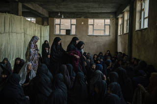 People mourn victims killed in powerful explosions outside a high school in AfghanistanÕs capital of Kabul, May 9, 2021. (Kiana Hayeri/The New York Times)