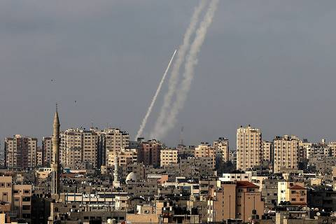 Rockets are fired from Gaza City, controlled by the Palestinian Islamist movement Hamas, towards Israel on May 10, 2021. (Photo by MAHMUD HAMS / AFP) ORG XMIT: 1710