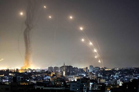 Rockets are launched towards Israel from Gaza City, controlled by the Palestinian Hamas movement, on May 11, 2021. (Photo by MAHMUD HAMS / AFP) ORG XMIT: 1794