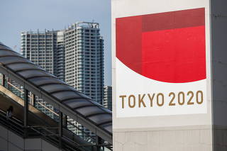 A sign advertising the Tokyo 2020 Olympic Games is displayed in Tokyo