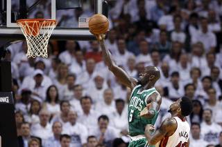 Boston Celtics' Kevin Garnett scores as Miami Heat's Udonis Haslem trails in the first quarter during Game 5 of their Eastern Conference Finals NBA basketball playoffs in Miami, Florida