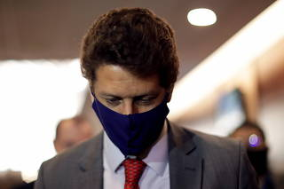 Brazil's Environment Minister Ricardo Salles reacts during a news conference in Brasilia