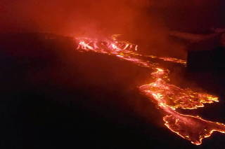 An aerial view shows lava flowing from the volcanic eruption of Mount Nyiragongo near Goma