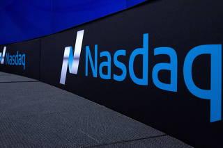 FILE PHOTO: The Nasdaq logo is displayed at the Nasdaq Market site in New York
