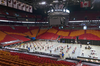 A COVID-19 vaccination event hosted by the Miami Heat at AmericanAirlines Arena, April 29, 2021. (Saul Martinez/The New York Times)