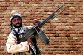 FILE PHOTO: Boko Haram leader Abubakar Shekau holds a weapon in an unknown location in Nigeria