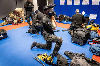 Australian Federal Police are seen during its Operation Ironside against organised crime