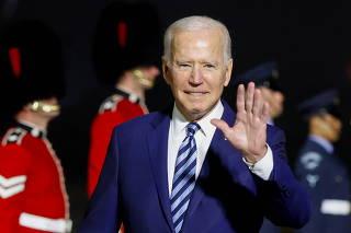U.S. President Joe Biden waves upon arrival at Cornwall Airport Newquay, near Newquay