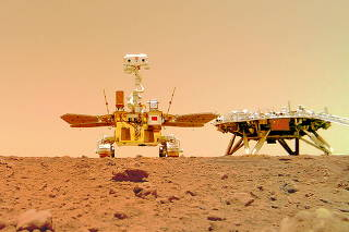 Handout image of Chinese rover Zhurong and the lander of the Tianwen-1 mission on Mars