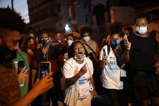 Demonstrators attend a protest in Rio de Janeiro against the death of Kathlen de Oliveira Romeu