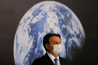 Brazil's President Jair Bolsonaro participates in the signing ceremony of Brazil and United States Agreement, at the Lunar NASA ARTEMIS Program, at the Planalto Palace in Brasilia