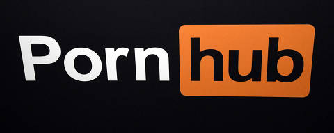 (FILES) In this file photo taken on January 23, 2018 a Pornhub logo is displayed at the company's booth at the 2018 AVN Adult Entertainment Expo at the Hard Rock Hotel & Casino in Las Vegas, Nevada. - Canada's privacy watchdog said May 10, 2021 it is investigating Pornhub over possible breaches involving the posting of sexually explicit videos online without the consent of people featured in them. (Photo by Ethan Miller / GETTY IMAGES NORTH AMERICA / AFP)