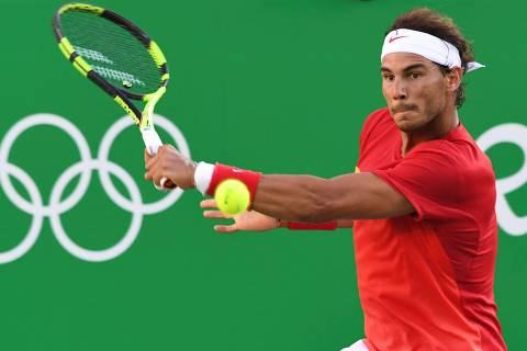 (FILES) In this file photo taken on August 13, 2016 Spain's Rafael Nadal returns the ball to Argentina's Juan Martin Del Potro during their men's singles semi-final tennis match at the Olympic Tennis Centre of the Rio 2016 Olympic Games in Rio de Janeiro. - Rafael Nadal has announced, June 17, he will not be playing at Wimbledon or the Olympic Games this year. (Photo by Luis Acosta / AFP) / XGTY