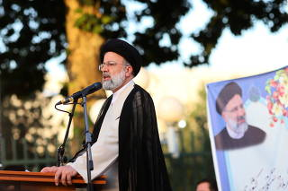 FILE PHOTO: Presidential candidate Ebrahim Raisi speaks during a campaign rally in Tehran