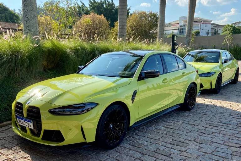 """Carro M3 2021, de cor São Paulo Yellow, utilizado para testes pelo repórter da Folha Eduardo Sodré; placa tem final """"14"""""""