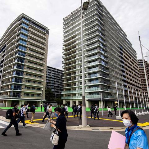 Members of the media visit the Olympic Village during a media tour of the Tokyo 2020 Olympic and Paralympic Village in Tokyo on June 20, 2021. (Photo by Behrouz MEHRI / AFP)