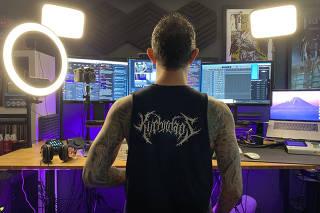Matthew Heafy, a member of the metal band Trivium, prepares to livestream music on Twitch from his home in Orlando, Fla., June 2, 2021. (Matt Grubb/The New York Times)