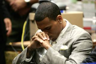 Brown sits during a preliminary hearing at a Criminal Court in Los Angeles