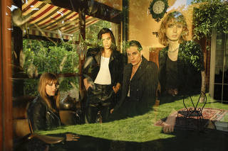 Members of Maneskin, the Italian rock band, from left: Victoria De Angelis, Ethan Torchio, Damiano David and Thomas Raggi, in Milan, June 10, 2021. (Valerio Mezzanotti/The New York Times)