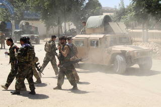 Afghan Commando forces are seen at the site of a battle field where they clash with the Taliban insurgent in Kunduz province